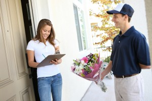 A-delivery-man-giving-flowers-300x200
